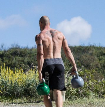 Kettlebell Farmer Carry Stock Photo